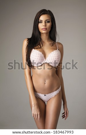 Beautiful woman in lingerie posing with big breast - stock photo