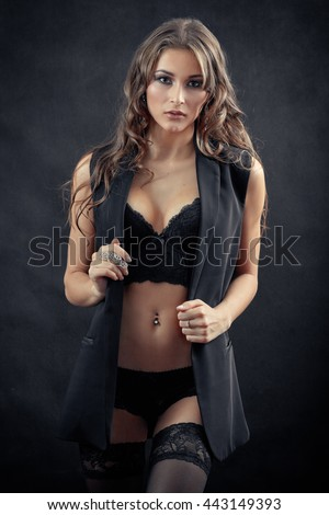 beautiful woman in lingerie undressing, toned image - stock photo