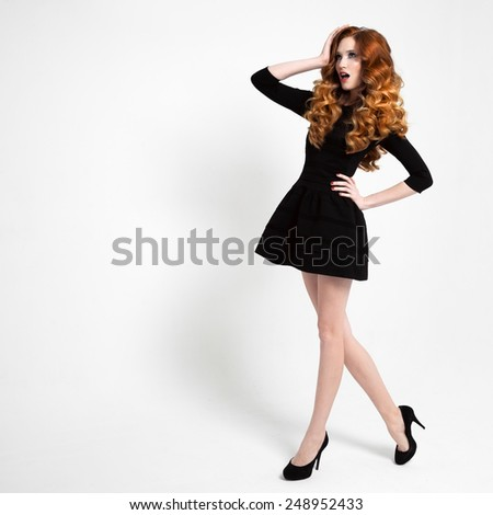 Beautiful Woman in Little Black Fashion Dress. - stock photo