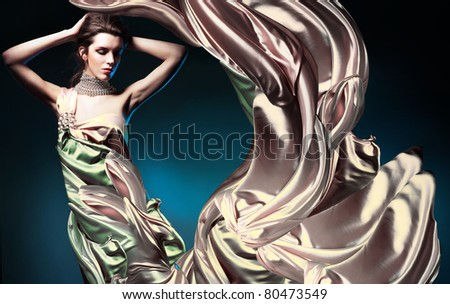 beautiful woman in long fairy dress - stock photo