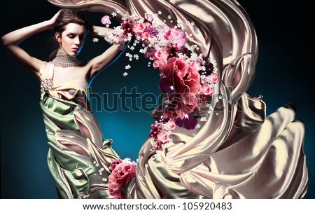 beautiful woman in long fairy dress and flowers - stock photo