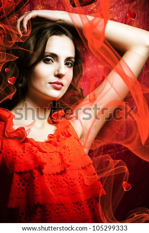 beautiful woman in love in red dress around fabric - stock photo