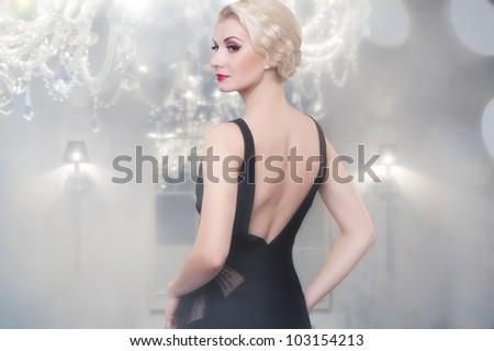 Beautiful woman in luxury interior - stock photo