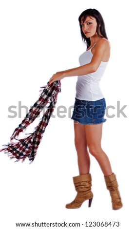 Beautiful woman in mini skirt and a scarf. - stock photo