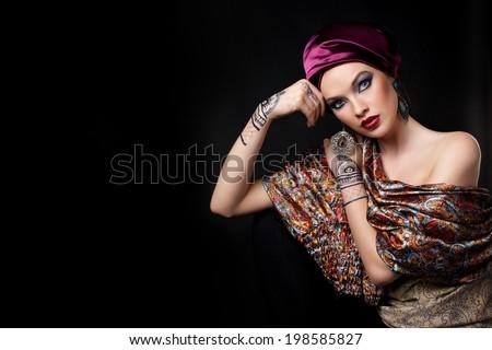 beautiful woman in oriental style with mehendi - stock photo