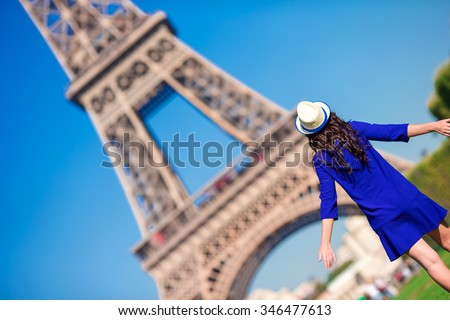 Beautiful woman in Paris background the Eiffel tower during summer vacation - stock photo