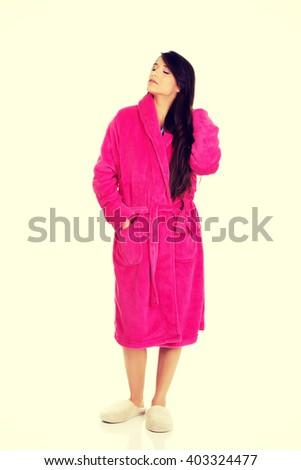 Beautiful woman in pink bathrobe. - stock photo