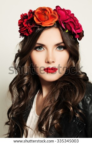 Beautiful Woman in Red Flowers Wreath - stock photo