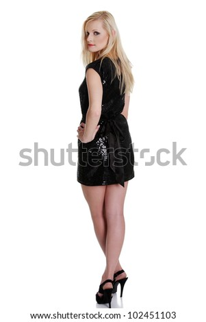 Beautiful woman in sexy black dress, isolated on white background - stock photo
