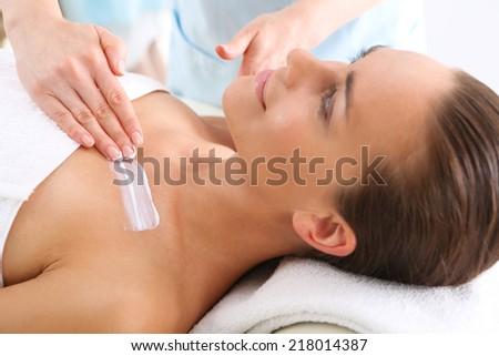Beautiful woman in spa salon .Attractive brunette woman in spa salon  - stock photo
