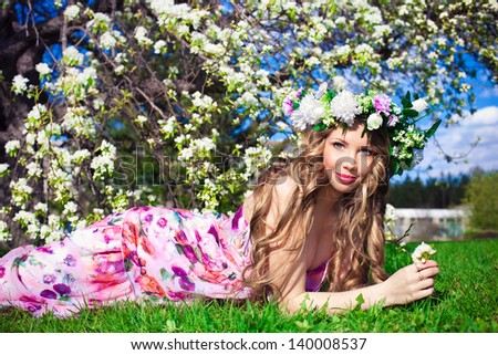 Beautiful woman in spring flowers - stock photo