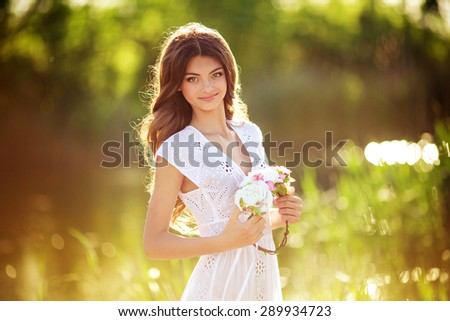 Beautiful woman in spring garden - stock photo