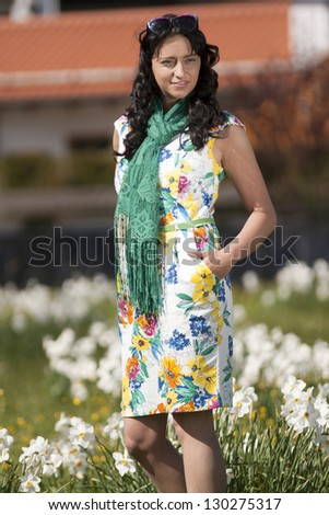 Beautiful woman in summer dress on a meadow / Lure of the summer - stock photo