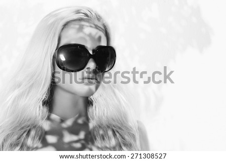 beautiful woman in sunglasses.beauty monochrome portrait blond girl - stock photo