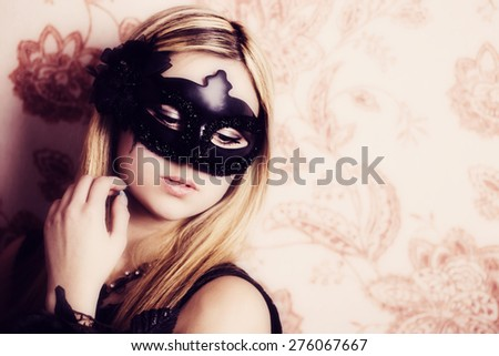 Beautiful Woman in the Carnival mask - stock photo