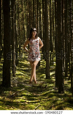 beautiful woman in the fores - stock photo