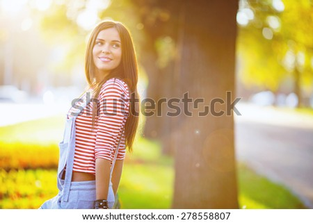 Beautiful woman in the park - stock photo