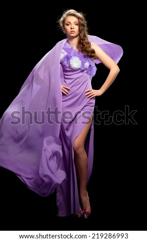 beautiful woman in the purple dress with a black background - stock photo