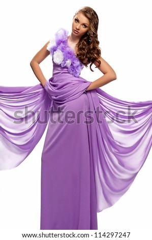 beautiful woman in the purple dress with a white background - stock photo