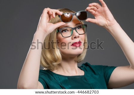 Beautiful woman in transformer glasses - stock photo