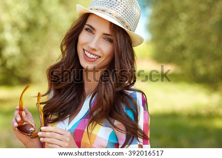 Beautiful woman in Tuscany, vacation in Italy - stock photo
