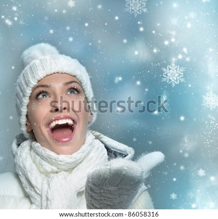 beautiful woman in warm clothing with snow - stock photo