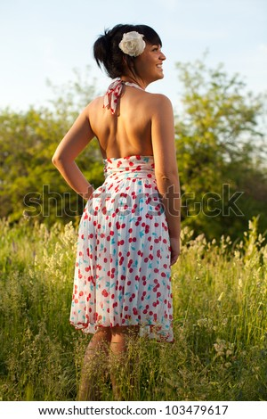 Beautiful woman in white dress at summer sunset. - stock photo