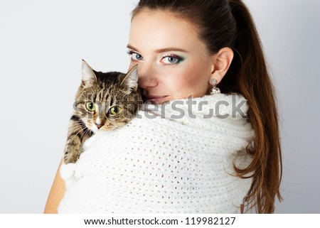 beautiful woman in white scarf with her cat - stock photo