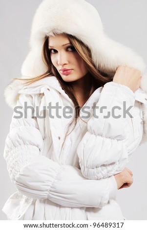 Beautiful woman in white winter clothing - stock photo