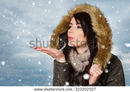 beautiful woman in winter clothes in snow  - stock photo