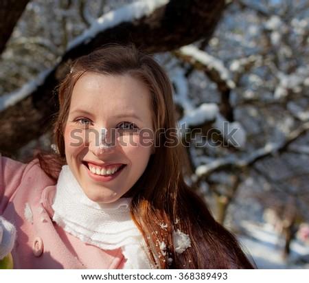 Beautiful woman in winter day - stock photo