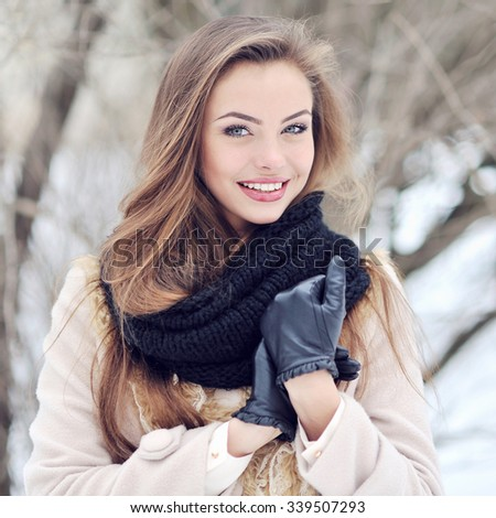 Beautiful woman in winter park - close up - stock photo