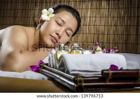 Beautiful woman indoor on spa and massage - stock photo