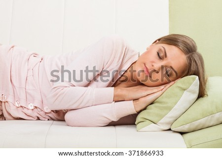 Beautiful woman is napping on sofa.Woman napping  - stock photo
