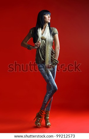 Beautiful woman isolated on a dark red full-length portrait - stock photo