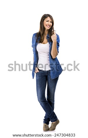 Beautiful woman isolated over white background and touching her hair - stock photo