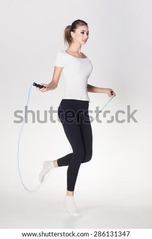 beautiful woman jumping rope - stock photo