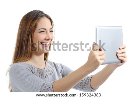 Beautiful woman laughing watching a digital tablet isolated on a white background - stock photo