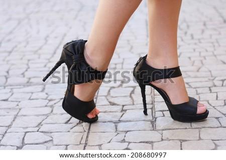 beautiful woman legs in high heel shoes outdoor shot - stock photo