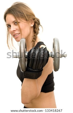 Beautiful woman lifting dumbbell on white background - stock photo