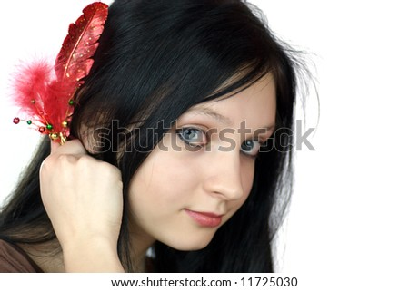 Beautiful woman looking at you holding bijouterie feather isolated on white - stock photo