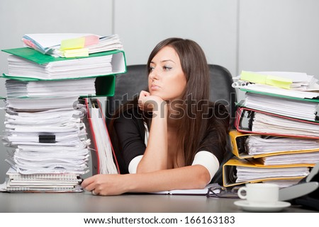 beautiful woman looking dreamingly in the office - stock photo