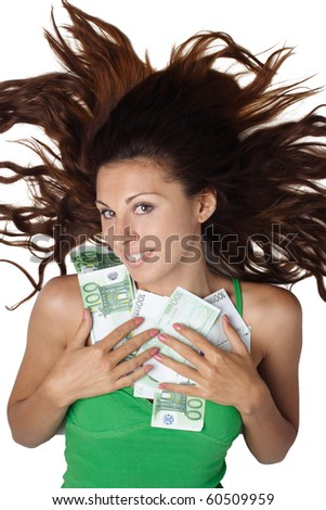 Beautiful woman lying and clasp money euro to breast and hair is dishevelled isolated - stock photo