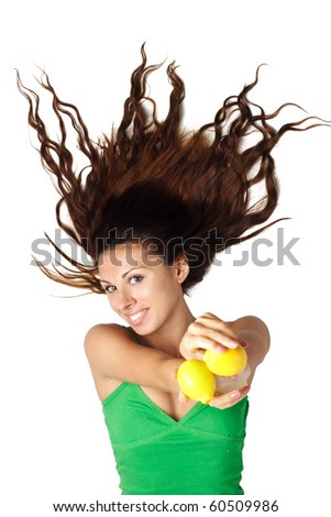 Beautiful woman lying and show lemons and hair is dishevelled isolated - stock photo