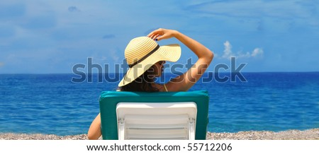 Beautiful woman lying on the beach ( lots of copy space ) - stock photo