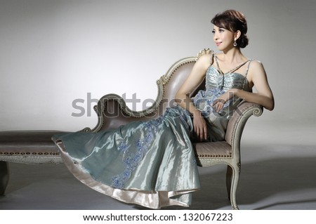Beautiful woman - makeup, luxury hairstyle, evening gown - stock photo