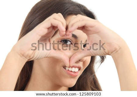 Beautiful woman making a heart shape with her hands and watching through it on a white isolated background - stock photo