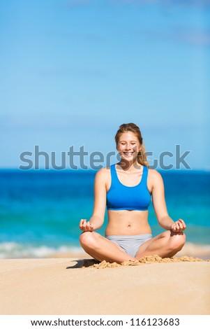 beautiful woman meditating on the beach in Hawai - stock photo