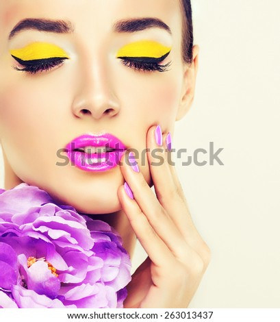Beautiful woman model with bright makeup  . Fashionable lilac manicure , purple nails - stock photo