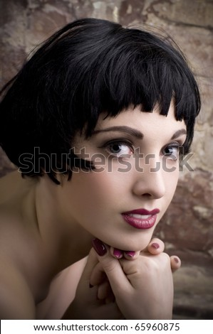 Beautiful woman on a background a brick wall - stock photo